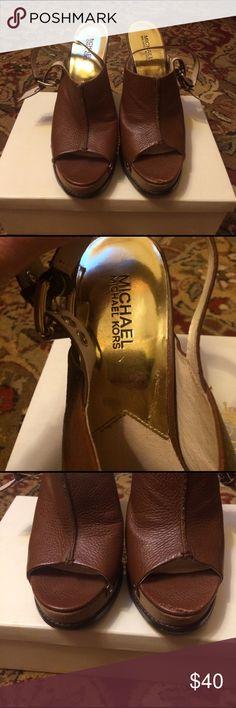 Michal Kors wedge open toe sandal. Michal Kors wedge open toe sandal. 5 inch wedge. Brown leather with gold rivets. Like new, worn one. Small mark on left toe. KORS Michael Kors Shoes Sandals