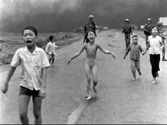 This Pulitzer Prize-winning photograph by AP photographer Nick Ut shows terrified children, including Kim Phuc, center, fleeing down a highway June 8, 1972, near Trang Bang, Vietnam, after an aerial napalm attack. The terrified girl had ripped off her burning clothes. Pham Thi Kim Phuc, now grown and married, forgave John Plummer, the U.S. officer who called in the strike, when they met last November at the Vietnam Veterans Memorial in Washington.
