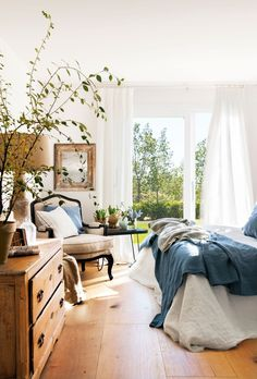 Gorgeous Details - Beautiful blues and wood furniture in this bright bedroom | Interior Design