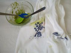 First food: pureed organic avocado. (and our first bib stains, too) (6-9 mo)