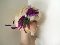 If/when I get married, I will be wearing flowers or feathers in my hair instead of a veil. But this is a bit of both and I LOVE the color.