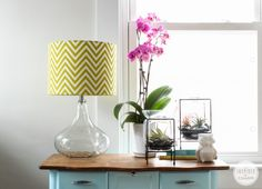 HG blogger, Michael's favorite HomeGoods find is this glass table lamp with a green chevron shade. Like the styling of the table