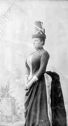 Mrs Hughes, in cuirass bodice suit with shelf bustle and flower pot hat, ca. 1887 / extra large format wet plate glass negative by Freeman &. (State Library of New South Wales) Boy does she ever look uncomfortable. 1880s Fashion, Edwardian Fashion, Vintage Fashion, Edwardian Clothing, Antique Photos, Vintage Photographs, Vintage Photos, Vintage Prints, Historical Costume