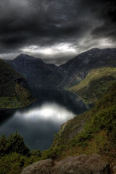 Geiranger Fjord. Why everyone so in love with blue clear skies? Dark is also good <3