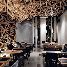 "Designed by DA Architects, their objective was to keep the 80 sqm restaurant interior neutral and simple. In total, 400 wooden triangles have been installed, representing DA architects' concept of creating an interior ""shell"". Sushi Bars, Restaurant Interior Design, Cafe Interior, Restaurant Interiors, Design Blog, Cafe Design, Food Design, Industrial Architecture, Architecture Design"