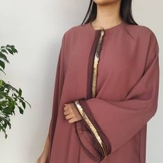 This stunning abaya captures the essence of the AW17 fashion trends. The Semi cape is both elegant and functional with a touch of Qabeela glamour with its striking gold and tulle detailing sure to create an instant impact in this seasons deep nude colour. Its a must have.