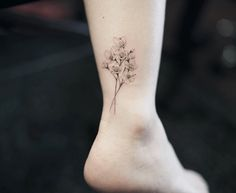 Colorless cherry blossom tattoo on ankle by Nando