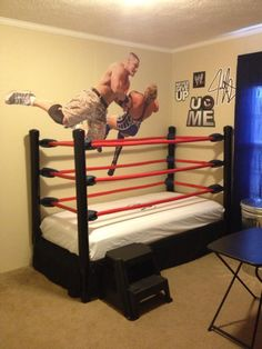 MY BOYS WOULD FLIP OUT!!!! DIY WWE Wrestling Bed. Kids room. I made this with an old bed frame. PVC pipe.  Rope covered with pipe insulation and wrapped with red electric tape. I used eyelets to run the rope trough and turnbuckles on the end so my son can take down the front ropes if he wants. The turnbuckle covers are made out of vinyl and padding.