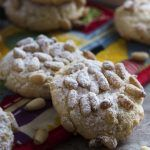 These gluten-free Italian pignoli cookies, adapted from Lidia Bastianich, are a great holiday cookie full of almonds and pine nuts! A great addition to a Christmas cookie tray.   justalittlebitofbacon.com