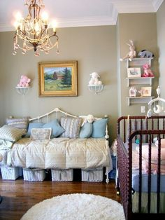Nice dignified nursery with no dumb stuff painted on walls. Like use of the day bed. I don't yet understand the need for a chandelier in every baby room.