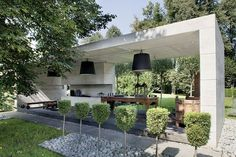 garden pavilion; roofed gazebo; exterior pendant;exterior fireplace; dwarf tree row; contemporary garden; carved table