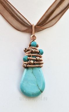 Wire wrapped copper turquoise teardrop pendant