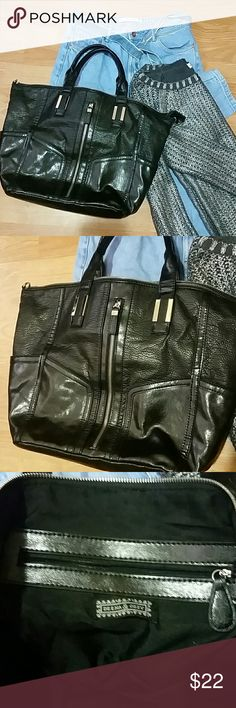 """Urban Outfitters (Deena and Ozzy) Black Purse Like new Deena and Ozzy purse purchased from Urban Outfitters. There are two functional zippers on the outside that could fit water bottles.  and one zipper pocket on the inside.  Medium sized purse/tote that can work as a cute book bag  Two compartments  on the side of the purse.  Missing Crossbody straps  Dimensions: height 12"""" length 16"""" width 6"""" Urban Outfitters Bags"""
