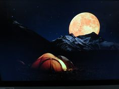 3f. This dramatic image works well. The moon and the tents share color. It could be used as an image for a outdoor equipment or adventure travel ad.