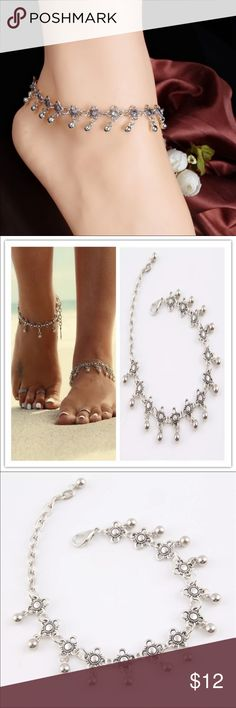 "Flower Anklet✨NEW ITEM✨ Cute silver toned zinc alloy anklet. Little flowers with dangling ball. New in package. This can clasp anywhere from 8.5""-10.5"". Listing is for one anklet. Jewelry"