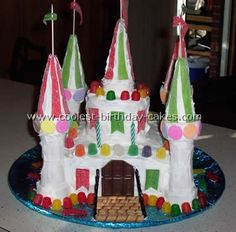 Not a huge fan of the decorations/colors used, but I like the basic shape of this castle cake.