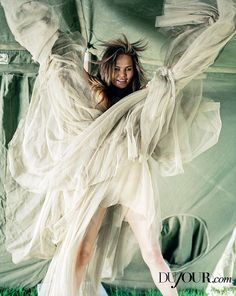 Wild: Chrissy posed in a dramatic dress in the photo shoot, shot by Bruce Webber...