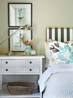 Bedside #table styling with framed #artwork and striped #headboard.  Beautiful soft color palette!