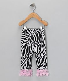 $9.99 Take a look at this Zebra & Light Pink Ruffle Leggings - Infant by Under The Hooded Towels on #zulily today!