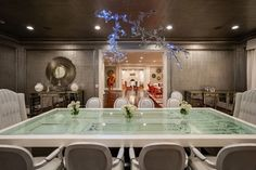 Dining room with an eclectic table and chandelier