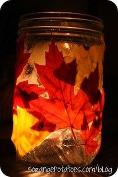 Leaf Lantern - did this in brownies too only we did felt turkeys that stuck up past the edge on a baby food jar and were a total fire hazard! We also used fake leaves but they look so much better with real leaves!