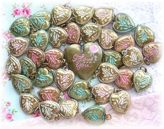 These are vintage brass hearts I have been enameling to use for charm bracelets...shabby chic colors Pink, Aqua, White..I love You Heart Locket...You can find a bracelet I made with these hearts in my Etsy Shop...♥•.¸¸.•♥  I got them from a lady who used to make charm bracelets years ago...