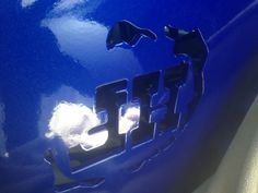 Closeup of paint and Hefty Fabworks logo on Raingler's Bithin' Blue Beast Xterra