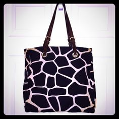 "M. KorsTote Handbag〽️✨ Boasting an eye-catchinggiraffe print, I personally love thiscanvas tote, very rare find & unique. I'm selling because I have two more of the same material prints but different style. This lovely purse features: magneticsnap closure * double straps * detachable logo charm * zippered and slip inside pockets * There is no medallion 13.5x3.5x13.5"". Strap drop length: 9"".〽️✨Pre-loved✨and very unique purse Michael Kors Bags Totes"