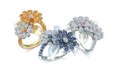 Mark Soley Daisy Flower rings in 18 carat gold set mixed colour sapphires and diamonds