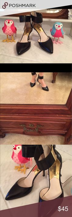 """GUC Michael Kors small ankle heels These are Michael Kors 3"""" heels with an ankle strap. The only wear I can see is to the bottoms of the shoes, worn only once. These are great when you want to get dressed up and don't feel like putting on high heels. They are great for work, because they are so comfortable. The have gold hardware and are a matte black and so very versatile. KORS Michael Kors Shoes Heels"""