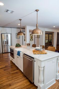 Large Oval Center Kitchen Island With Gray Wainscoting Topped With White  Marble Countertops Include A Farm Sink With A Gooseneck Fu2026