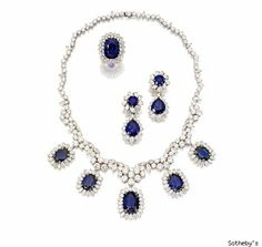 picture of queen elizabeth's sapphire and diamond loop necklace   gold, diamond and sapphire necklace; platinum, diamond and sapphire earrings and ring