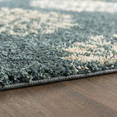Found it at Wayfair - Cowden Slate Blue Exploded Medallions Woven Area Rug