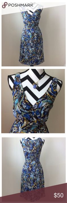 """{Anthropologie} Oak Apple Dress {Anthropologie} Oak Apple Dress by Moulinette Soeurs. 'Swirls of blue and orange color this silk surplice frock, like glimpses of unwashed sky thru the trees.' Hidden side zip. V neck. 100% silk. Laying flat approx 37"""" shoulder to hem, approx 15"""" pit to pit. Size 2. Excellent condition. #677 Anthropologie Dresses"""