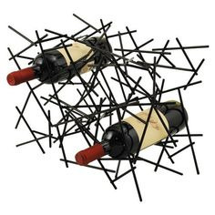 """The Nest 6 Bottle Wine Rack by True Fabrications. $34.95. Fits all standard sized bottles. Painted metal. 6-bottle wine rack. 17X12X9"""". 2 Pounds. The Nest Wine Rack was designed to bring the look and feel of modern art into your wine collection. With painted black metal rods, the rack can house up to 6 standard-sized bottles."""