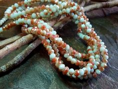 Crystal Rhondelle, 3x4mm, Opal Mint Orange Luster, Tiaria Crystal, 70 pieces per Strand, 7-8 Inch Strand, Priced per Strand by DragonflyBeadsStudio on Etsy