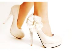 Image from http://img.loveitsomuch.com/uploads/201212/24/wh/white%20high%20heel%20shoes%20for%20women%20-%20cute%20white%20high%20heel%20shoes%20for%20women%20-f23308.jpg.
