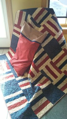 "We used our FREE ""Lake and Logs"" pattern to create this patriotic quilt.  Get the FREE pattern on our blog."