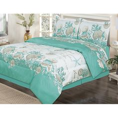 Curl up in ultimate comfort with this quilt set from Beatrice. Set includes comforter, bed skirt, and 2 shams (1 for twin size). Shell Wreath set features a colorful seashell and starfish pattern.