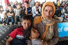 A Syrian mother and her children wait at the Sahela arrival centre. The UN refugee agency (#UNHCR) and local authorities are responsible for registering #refugees. Photograph: Christian Jepsen
