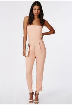 Add a touch of sophistication to your party wear with this chic tailored jumpsuit. The simple cut piece features a bandeau top with darting for extra detailing and wide legs for an elegant finish. Go simple with your accessories and team wi...