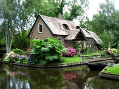 Giethoorn in the Dutch Province of Overijssel.  A village with no roads, only water!