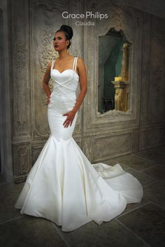 A Satin Fit N Flare Fishtail Wedding Dress With Wrap Over Straps To Sculpt The Body