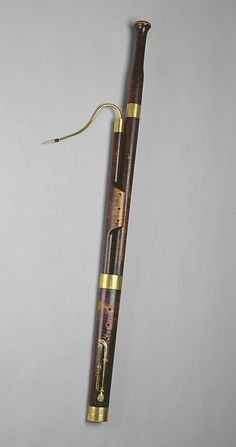 "1811 American (New York) Bassoon in C at the Metropolitan Museum of Art, New York - From the curators' comments: ""This bassoon is built in the typical four sections: bell, long or bass, butt, and wing. The instrument has four brass keys (one of which is missing), mounted in brass saddles, and four brass rings and a brass crook. This instrument is one of the earliest bassoons made in North America known to survive."""
