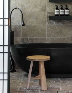minimal bathroom - natural - black tub