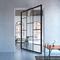 Modern glass pivot doors with an aluminium frame PORTAPIVOT 6530 system Portapivot might just be the ideal solution to make a unique design statement in your cl Partition Door, Pivot Doors, Glass Partition, Internal Doors, Sliding Doors, Door Design, House Design, Window Design, Modern Entrance Door