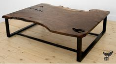 UHURU SLAB COFFEE TABLE // Shown in walnut, blackened steel, 60x32x18H, 2010 // DESCRIPTION: The Slab Coffee Table is created from a one-of-a-kind hardwood slab set on a steel frame of 2″ x 1″ tubing with a blackened or powder coated finish. Our large wood slabs are locally milled and dried and come from sustainably harvested trees. Like diamonds, no two slabs are the same. Grain, color and natural characteristics are different with every slab, making each piece unique. // uhurudesign.com