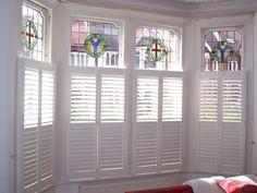 Wooden shutters in bay window