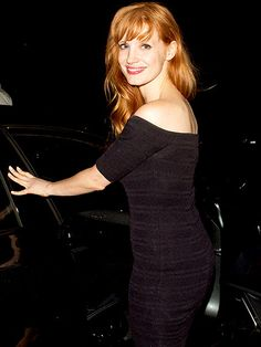 OPEN DOORS | Before hopping into her car, Jessica Chastain stops for one last photo Wednesday night following dinner with her boyfriend Gian Luca Passi de Preposulo at a restaurant in Santa Monica, California.