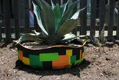 If you live in a hot area this is a great looking succulent planter. Planter made with an old tire.